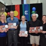 IPC Health Board member Sanela Osmic, Uncle Merv, Aunty Marlene, Uncle Gary and IPC Health CEO Jayne nelson holding up Reconciliation Action Plan booklets