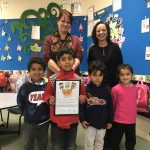 Parkwood Green Kindergarten teacher and students receiving Smiles for Miles certificate from IPC Health CEO Jayne Nelson